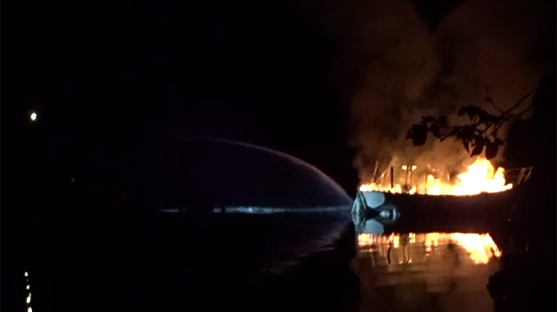 Fire officials say a boat caught fire, exploded and sank into Victoria's Gorge Waterway early Thursday morning. May 31, 2018.