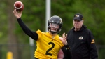 Johnny Manziel is seen with teammates on the field at McMaster University during Tiger Cats training camp in Hamilton, Ont., on Sunday, May 20, 2018. THE CANADIAN PRESS/Peter Power