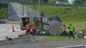 A truck carrying liquid sugar flipped on its side while heading from the Bonaventure Expressway to the Champlain Bridge on the morning of Thur., May 31, 2018.