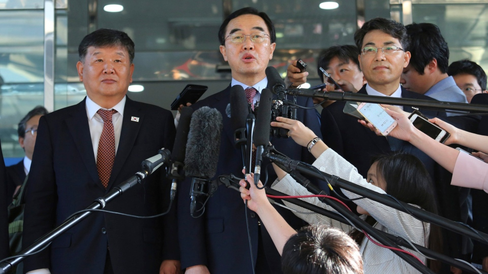 South Korean Unification Minister Cho Myoung-gyon, center, speaks to the media before leaving for the border village of Panmunjom to attend South and North Korea meeting, at the Office of the South Korea-North Korea Dialogue in Seoul, South Korea, Friday, June 1, 2018. (AP Photo / Ahn Young-joon)