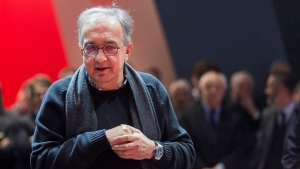 Fiat Chrysler CEO Sergio Marchionne stands beside a Ferrari car as he attends the press day at the 88th Geneva International Motor Show in Geneva, Switzerland, Tuesday, March 6, 2018. (Cyril Zingaro/Keystone via AP)