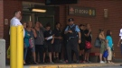 Commuters are shown waiting for shuttles buses at St. George Station on Friday morning.