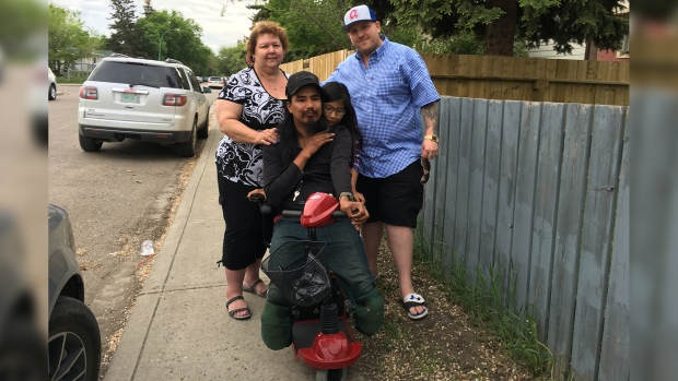 Howard Desjarlais receives a scooter from Sylvia S