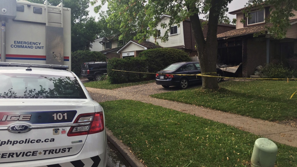 Police and other authorities investigate a fire at a home on Queensdale Crescent in Guelph on Monday, June 4, 2018. (Emma Ens / CTV Kitchener)
