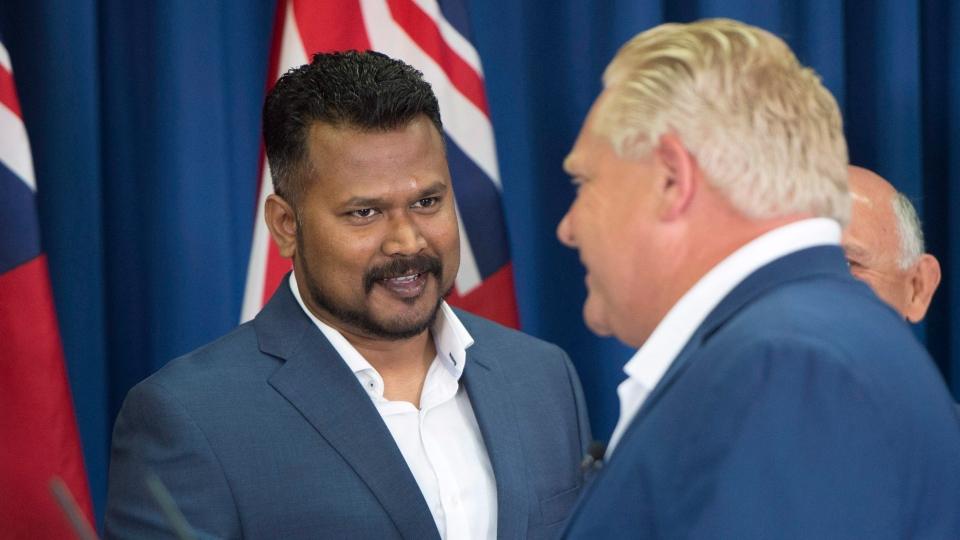 Ontario PC leader Doug Ford shakes hands with candidate Roshan Nallaratnam (left) after making a campaign announcement in Toronto on Monday, June 4, 2018. THE CANADIAN PRESS/Frank Gunn
