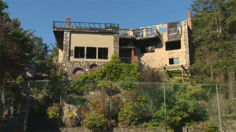 A burned-out vacant home on Beach Drive in Oak Bay is shown. June 4, 2018. (CTV Vancouver Island)