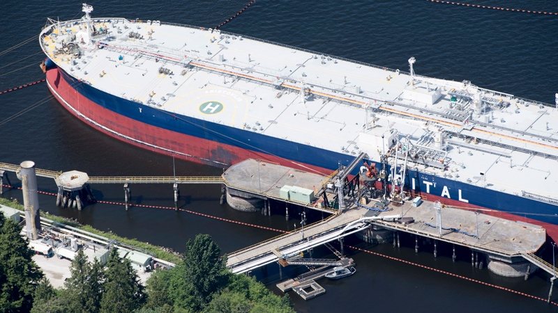 A aerial view of Kinder Morgan's Trans Mountain marine terminal filling a oil tanker in Burnaby, B.C., is shown on Tuesday, May 29, 2018. THE CANADIAN PRESS Jonathan Hayward