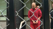 Kenneth Jacob Fenton is led away from the Duncan Law Courts in handcuffs. Fenton pleaded guilty Monday to two charges related to a car crash in May 2016. June 4, 2018. (CTV Vancouver Island)