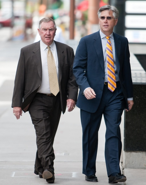 Phoenix Coyotes owner Jerry Moyes, left, walks with his lawyer Steve Roman as they head to U.S. Bankruptcy Court in Phoenix, on Tuesday, June 9, 2009. (AP / Aaron J. Latham)