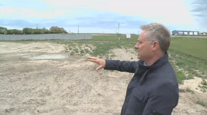 Allen Kilback looks at the land where he plans to develop a pot shop in the R.M. of Edenwold