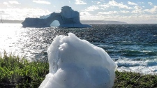 An iceberg is seen in Amherst Cove