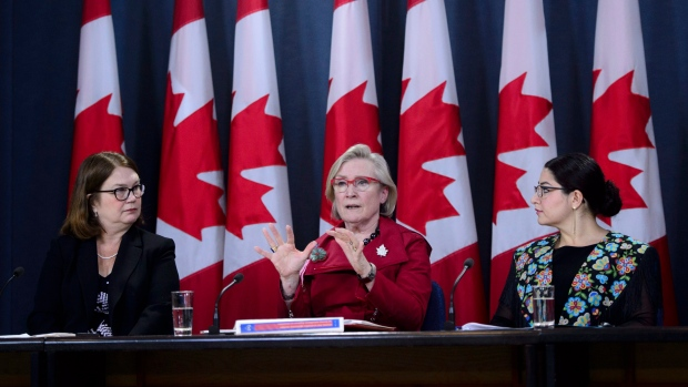 Carolyn Bennett, Minister of Crown-Indigenous Relations and Northern Affairs, speaks as she is joined by Jane Philpott, Minister of Indigenous Services, left, and Maryam Monsef, Minister of Status of Women, during a press conference at the National Press Theatre in Ottawa on Tuesday, June 5, 2018, in response to the Interim Report of the National Inquiry into Missing and Murdered Indigenous Women and Girls and the Commission's request for an extension THE CANADIAN PRESS/Sean Kilpatrick
