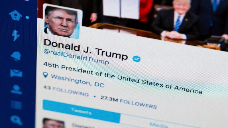 This April 3, 2017, file photo shows U.S. President Donald Trump's Twitter feed on a computer screen in Washington. (AP Photo/J. David Ake, File)