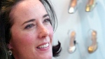 Designer Kate Spade poses with shoes from her next collection in New York, May 13, 2004. (AP Photo/Bebeto Matthews)