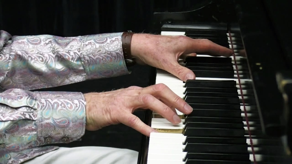 Jim Hayward plays the piano at the River Run Centre in Guelph on Tuesday, June 5, 2018.