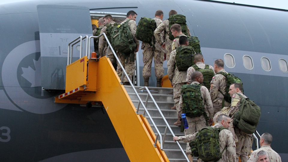 Canadian forces members board an Airbus CC-150 Polaris, from CFB Trenton, in Trenton, Ont., on Thursday, Oct. 16, 2014. (THE CANADIAN PRESS/Lars Hagberg)