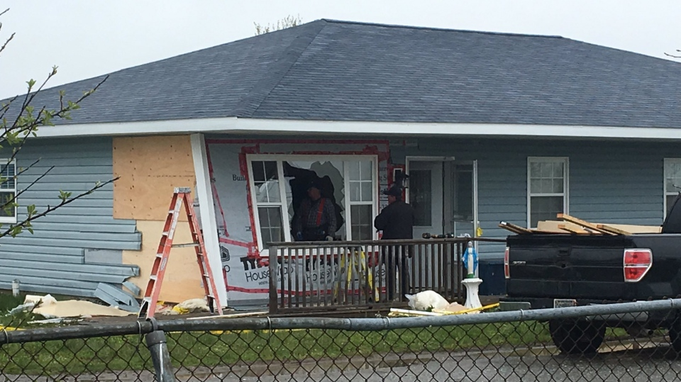 A woman has been arrested for impaired driving after a car crashed into a home in Reserve Mines, N.S. on June 5, 2018.
