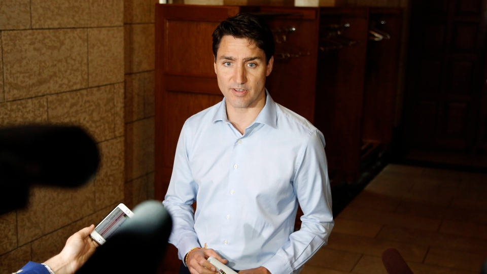 Prime Minister Justin Trudeau speaks to reporters before a caucus meeting on Parliament Hill in Ottawa on Wednesday, June 6, 2018. THE CANADIAN PRESS/ Patrick Doyle