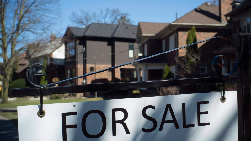 A for sale sign is shown in front of west-end Toronto homes Sunday, April 9, 2017. (THE CANADIAN PRESS/Graeme Roy)