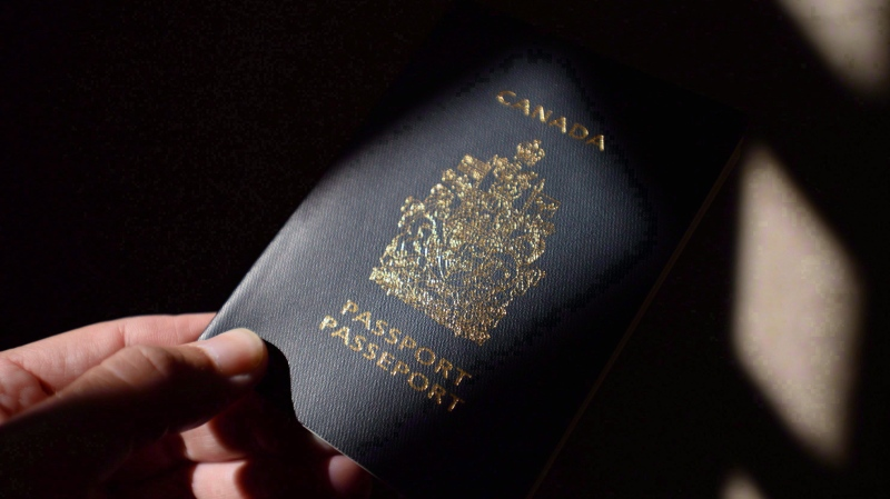 A Canadian passport is displayed in Ottawa on Thursday, July 23, 2015. (THE CANADIAN PRESS/Sean Kilpatrick)