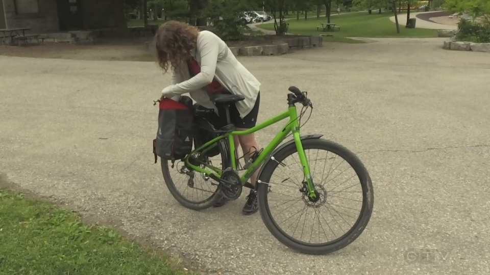 Kate Osborn shows off the saddle bags on her bicycle.