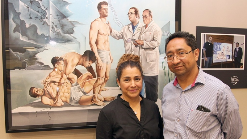 """Dr. Jose Tellez-Zenteno (right) poses in front of Mexican artist Eduardo Urbano Merino's painting """"Epilepsy, leaving the nightmare behind"""" in this undated handout photo. (THE CANADIAN PRESS/HO, Daniel Hallen)"""