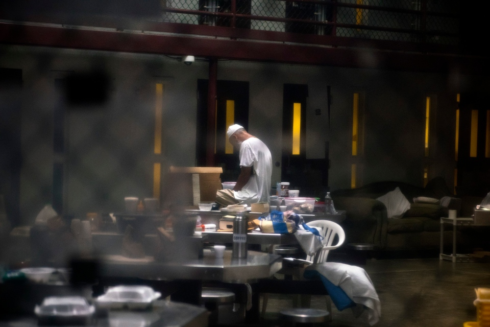 In this Wednesday, June 6, 2018 photo, reviewed by U.S. military officials, a detainee, name and facial identification not permitted, prays inside the Camp VI detention facility at Guantanamo Bay U.S. Naval Base, Cuba. (AP Photo/Ramon Espinosa)