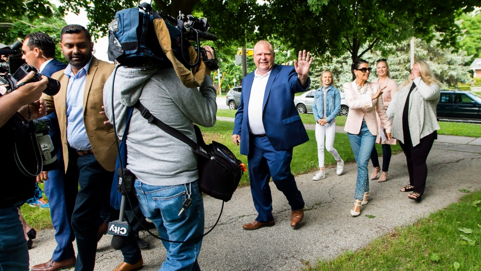 Ontario PC leader Doug Ford, centre, walks with his family to cast their votes in Toronto, on Thursday, June 7, 2018. (THE CANADIAN PRESS/Nathan Denette)