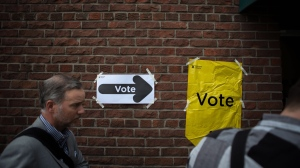Voters line up to cast a ballot in the Ontario provincial elections in Toronto on Thursday, June 7, 2018. THE CANADIAN PRESS/Chris Donovan