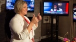 NDP Leader Andrea Horwath gives a thumbs-up watching the election results come with family and supporters her hotel room in Hamilton, Ont., on Thursday, June 7, 2018. THE CANADIAN PRESS/Peter Power
