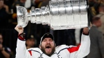 Washington Capitals left wing Alex Ovechkin, of Russia, hoists the Stanley Cup after the Capitals defeated the Golden Knights in Game 5 of the NHL hockey Stanley Cup Finals Thursday, June 7, 2018, in Las Vegas. (AP Photo/John Locher)