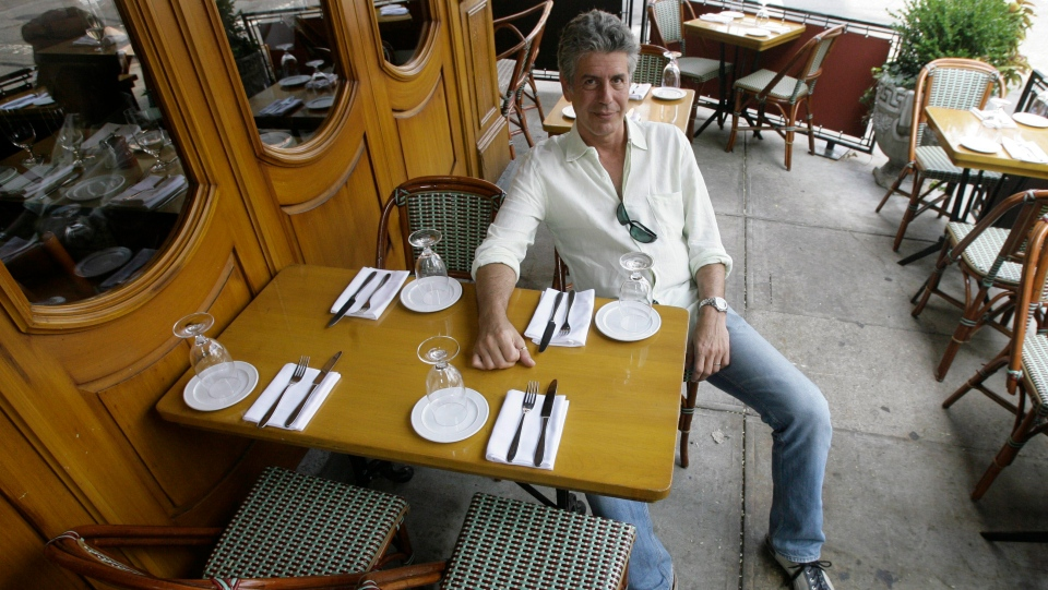 "Anthony Bourdain, host of theTravel Channel's ""No Reservations,"" poses in a New York restaurant, Wednesday, Aug. 8, 2007. (AP Photo/Mary Altaffer)"