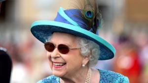 In this May 31, 2018 file photo, Queen Elizabeth II smiles, during a garden party at Buckingham Palace in London. (Yui Mok/PA via AP, File)