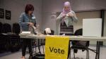Poll clerk Carmela Caccavo, left, and Deputy Returning Officer Manal El-Achi set up the Mississauga-Erin Mills polling station on University of Toronto, Mississauga Campus on Thursday, June 7, 2018. (THE CANADIAN PRESS / Marta Iwanek)