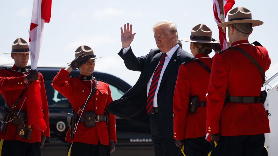 U.S. President Donald Trump stepping off Air Force One at Canadian Forces Base Bagotville, on  June 8, 2018. (Evan Vucci / AP)