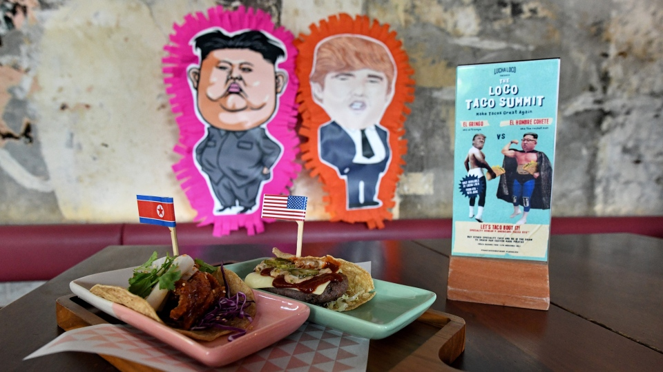 "A food display of ""El Trumpo"" (L) and ""Rocket Man"" (R) tacos is seen at a restaurant in Singapore on June 7, 2018, ahead of the summit between U.S. President Donald Trump and North Korean leader Kim Jong Un on June 12."