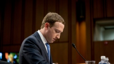 In this April 10, 2018, file photo, Facebook CEO Mark Zuckerberg pauses while testifying before a joint hearing of the Commerce and Judiciary Committees on Capitol Hill in Washington about the use of Facebook data to target American voters in the 2016 election. (AP Photo/Andrew Harnik, File)