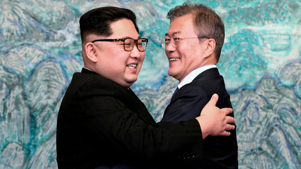 In this April 27, 2018 file photo, North Korean leader Kim Jong Un, left, and South Korean President Moon Jae-in embrace each other after signing on a joint statement at the border village of Panmunjom in the Demilitarized Zone, South Korea. (Korea Summit Press Pool via AP, File)