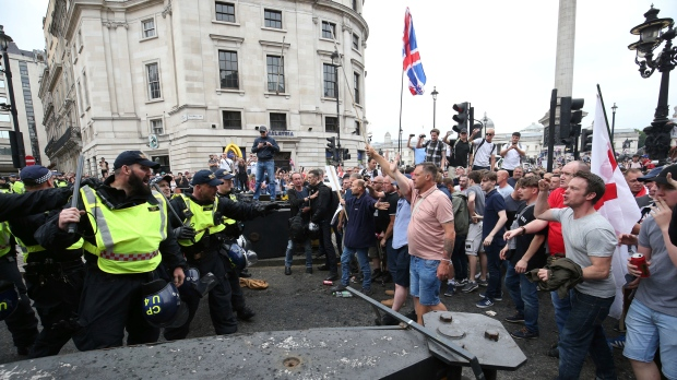 Thousands march for far-right activist convicted of contempt of court
