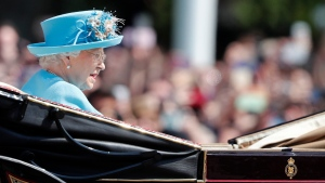 Queen Elizabeth II rides in a carriage to attend the annual Trooping the Colour Ceremony in London. (AP Photo / Frank Augstein)