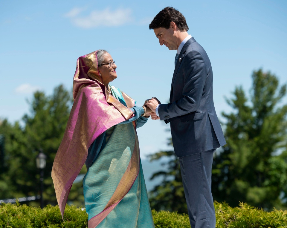 Canada's Prime Minister Justin Trudeau shakes hands with Bangladesh's Prime Minister Sheikh Hasina as he welcomes representatives from outreach countries and international organizations during the G7 leaders summit in La Malbaie, Que., on Saturday, June 9, 2018. (THE CANADIAN PRESS/Justin Tang)