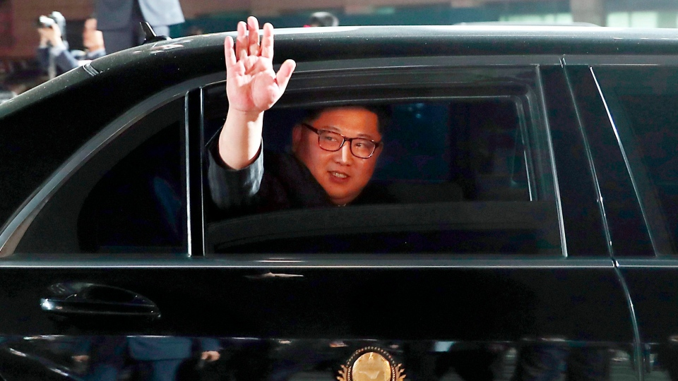 In this April 27, 2018, file photo, North Korean leader Kim Jong Un waves from a car as he returns to North Korea after the meeting with South Korean President Moon Jae-in at the border village of Panmunjom in the Demilitarized Zone. (Korea Summit Press Pool via AP, File)