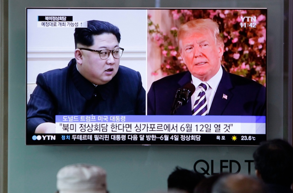 In this May 26, 2018, file photo, people watch a TV screen showing file footage of U.S. President Donald Trump, right, and North Korean leader Kim Jong Un during a news program at the Seoul Railway Station in Seoul, South Korea. (AP Photo/Lee Jin-man)