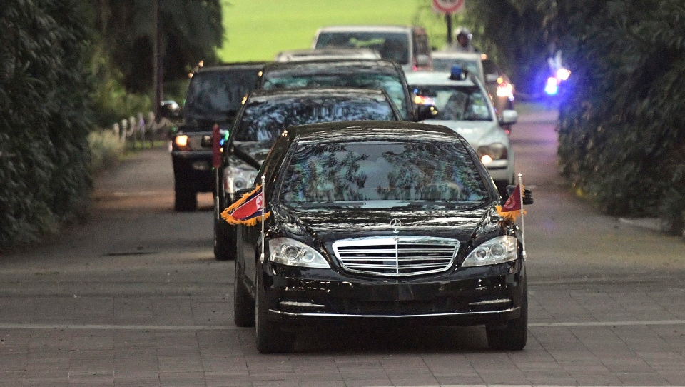 The motorcade carrying North Korean leader Kim Jong Un leaves the Istana, or Presidential Palace, in Singapore on Sunday, June 10, 2018. (AP Photo/Joseph Nair)