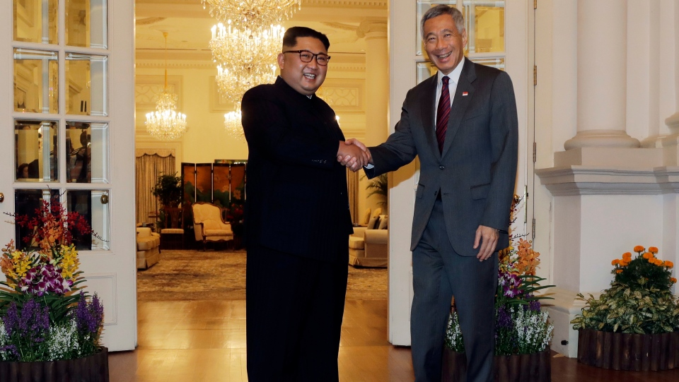North Korean leader Kim Jong Un meets with Singapore's Prime Minister Lee Hsien Loong at the Istana or presidential palace on Sunday, June 10, 2018, in Singapore. (AP Photo/Wong Maye-E)