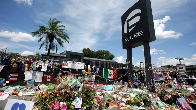In this July 11, 2016, file photo, a makeshift memorial continues to grow outside the Pulse nightclub, the day before the one month anniversary of a mass shooting, in Orlando, Fla. (AP Photo/John Raoux, File)