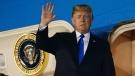 President Donald Trump arrives at Paya Lebar Air Base for a summit with North Korean leader Kim Jong Un, Sunday, June 10, 2018, in Singapore. (AP / Evan Vucci)