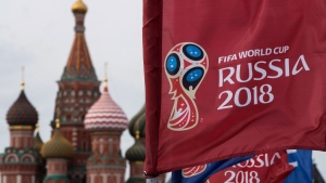 In this June 4, 2018, file photo, a flag with the logo of the World Cup 2018 on display with the St. Basil's Cathedral in the background, in Moscow, Russia. (AP / Pavel Golovkin, File)