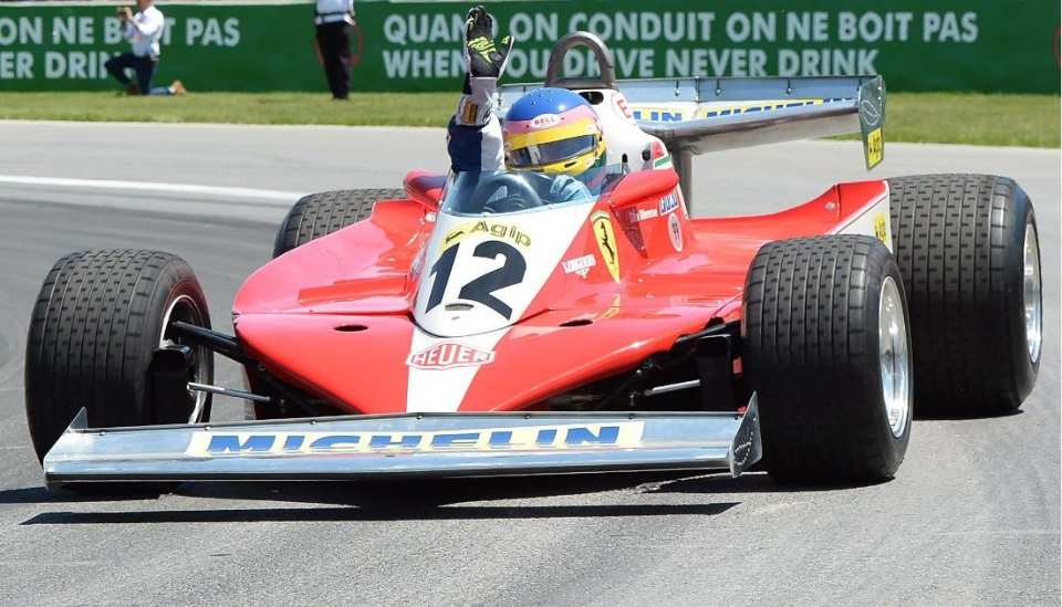 Former Formula 1 racer Jacques Villeneuve drives his father Gilles Villeneuve's 1978 Ferrari during the drivers' parade prior to the Canadian Grand Prix Sunday, June 10, 2018 in Montreal. THE CANADIAN PRESS/Ryan Remiorz