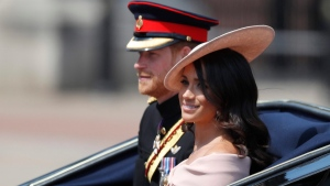 Prince Harry, left, and Meghan, Duchess of Sussex ride in a carriage to attend the annual Trooping the Colour Ceremony in London, Saturday, June 9, 2018.(AP Photo/Frank Augstein)